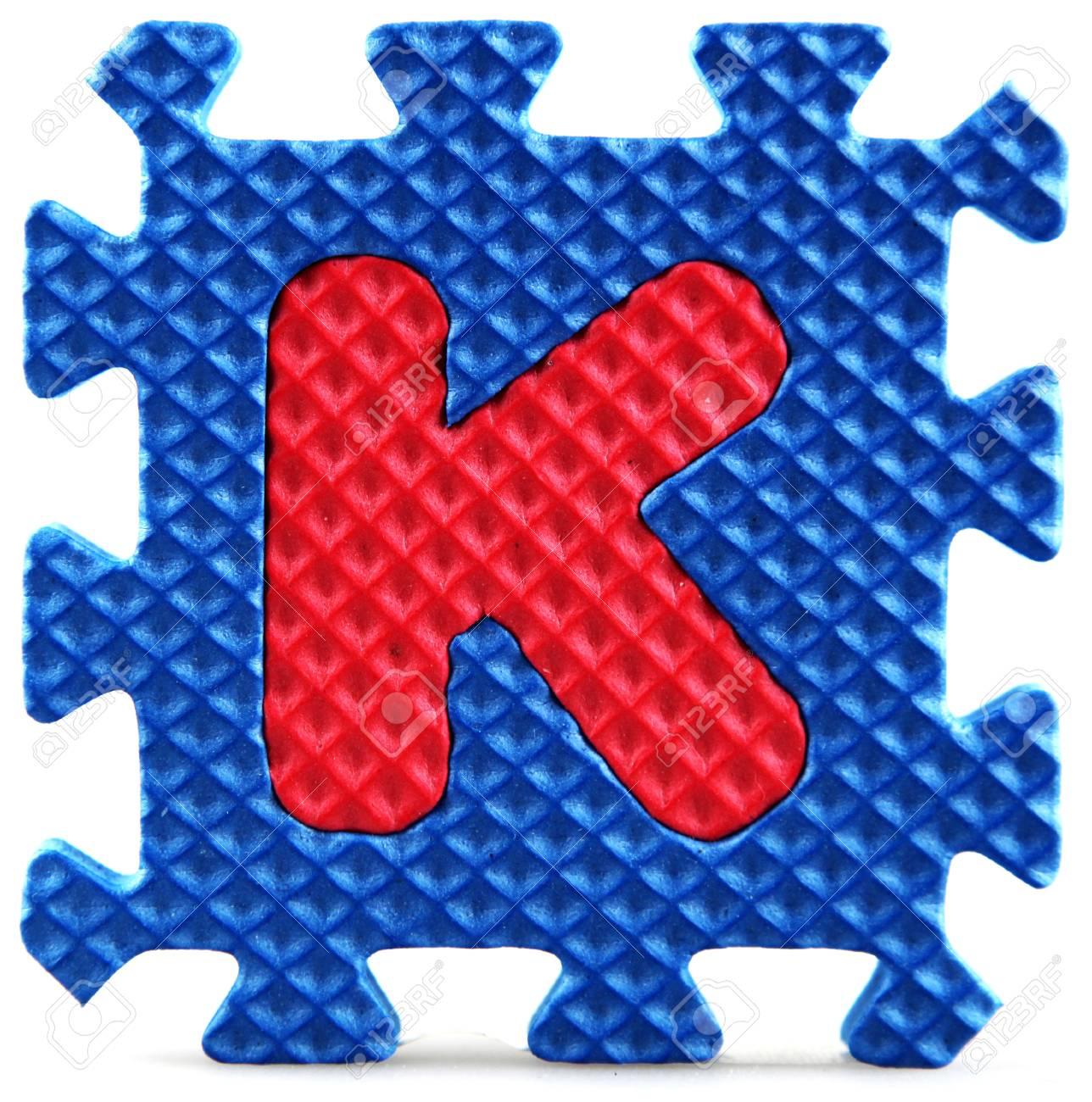 Alphabet puzzle pieces on white background Stock Photo - 9758948