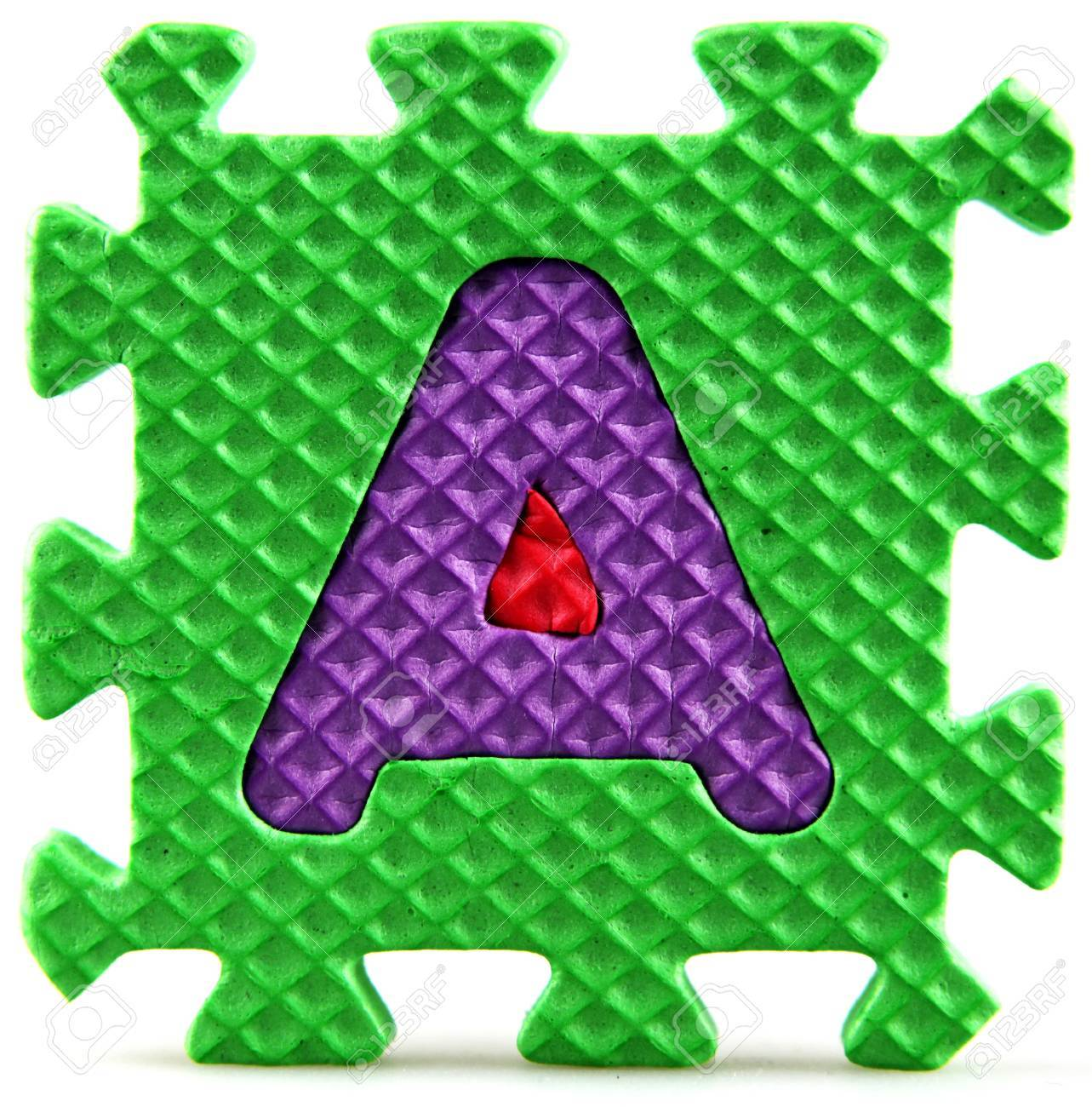 Alphabet puzzle pieces on white background Stock Photo - 9758952