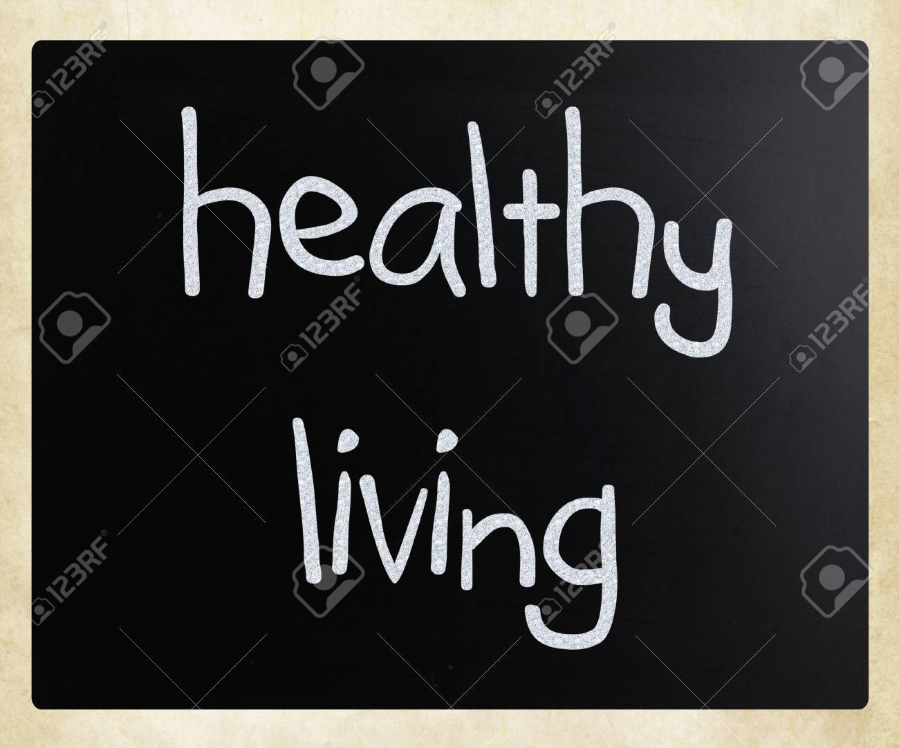 Healthy living, handwritten with white chalk on a blackboard. Stock Photo - 14351599