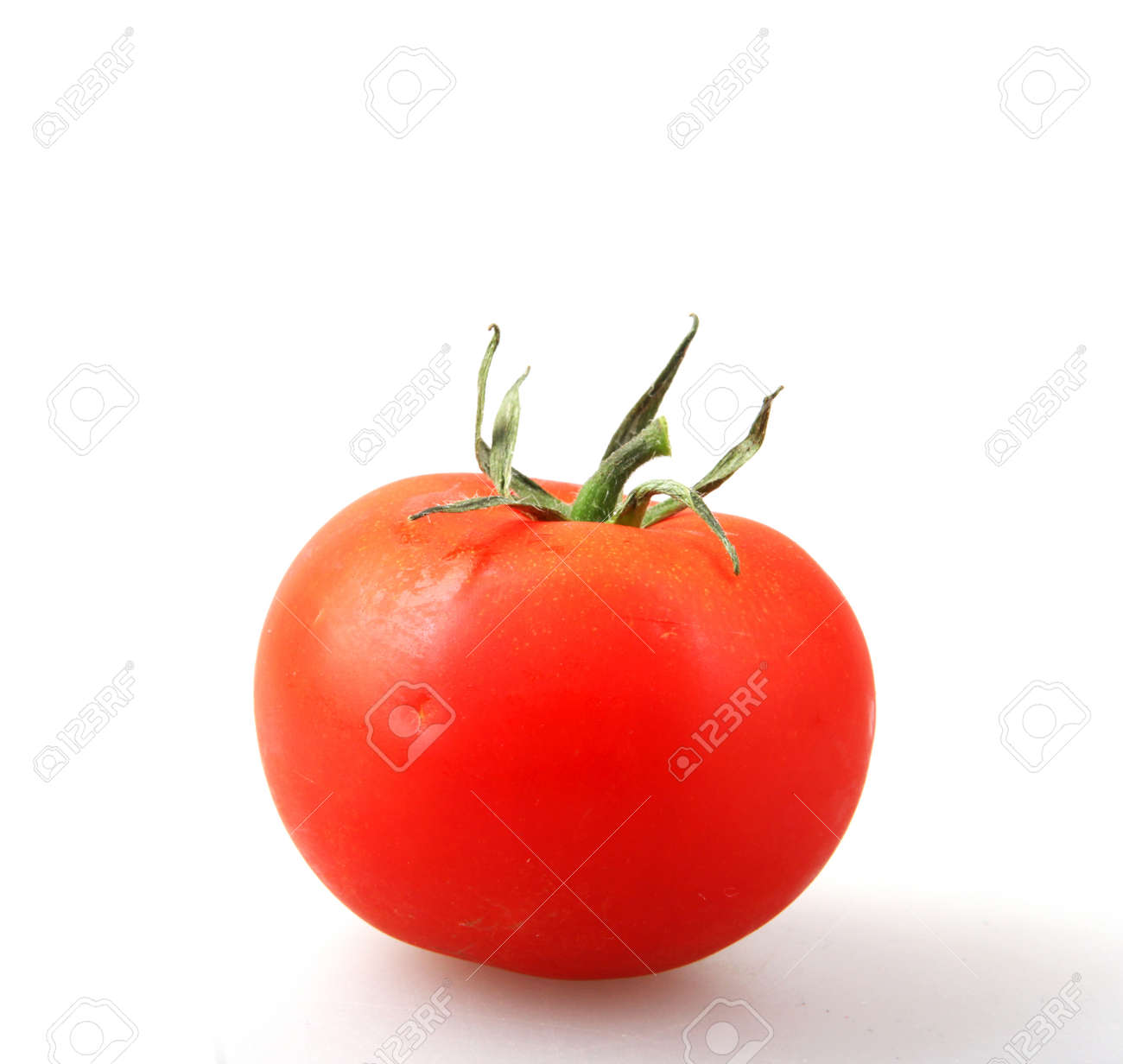 Close-Up Of Red Tomato On White Background - 123725486
