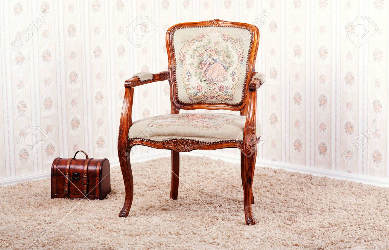 photo vintage room vith wallpaper and old antique armchair
