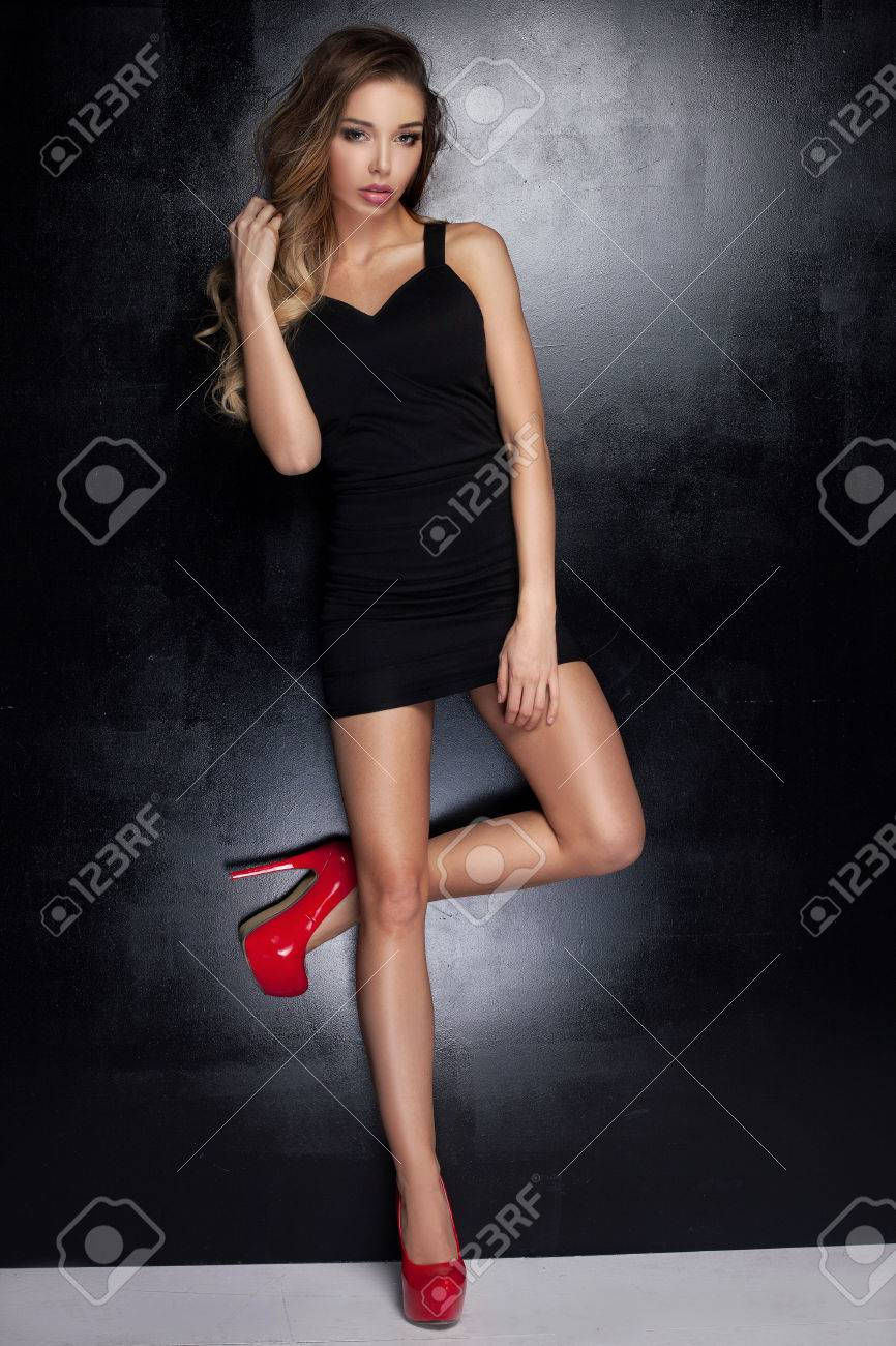 Young Fashionable Sexy Woman Posing In
