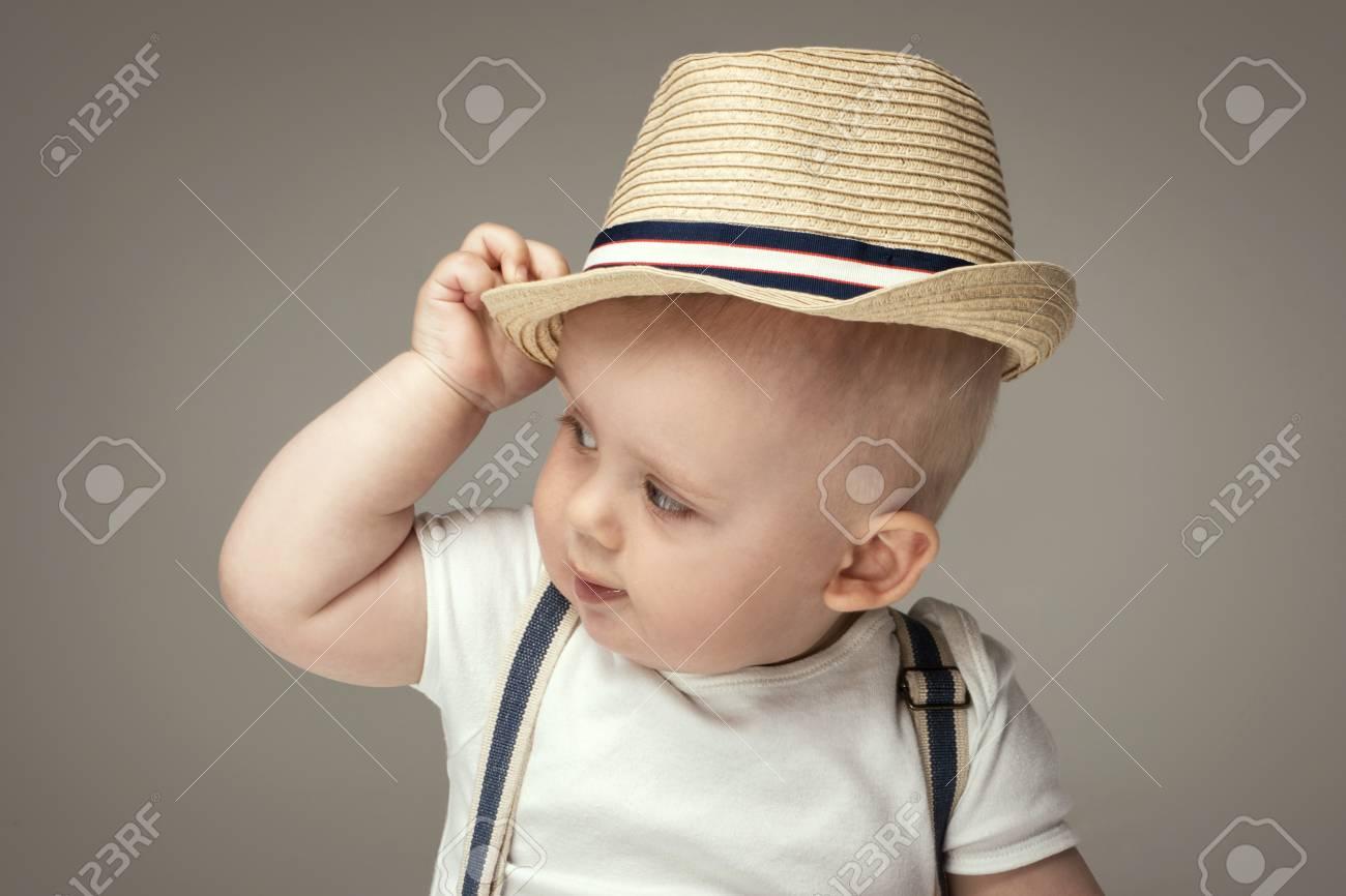 4780440549ec Cute baby boy posing in summer hat. Adorable little child in studio. Stock  Photo