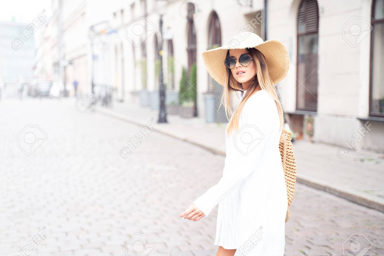 Young beautiful happy woman on vacation wearing summer hat and fashionable sunglasses. - 152702342