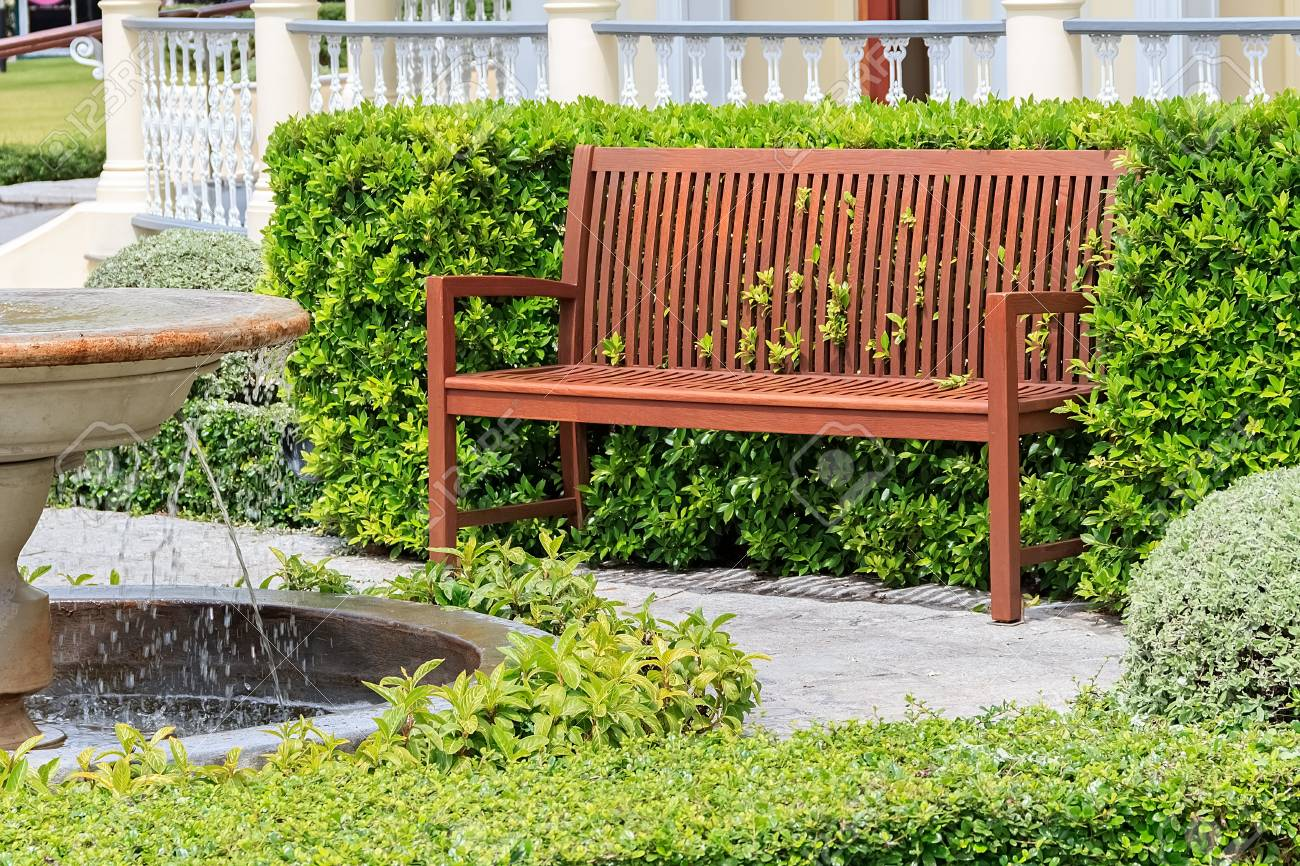 Awesome Wooden Bench Near Fountain In Patio At The Back Of The House Machost Co Dining Chair Design Ideas Machostcouk