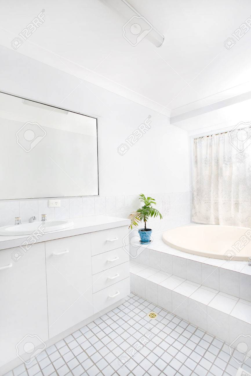 Brightly lit airy bathroom with white tiles Stock Photo - 1366690