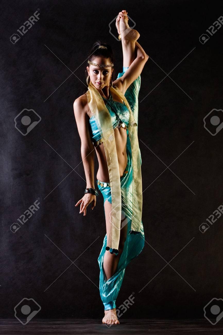 Dancer in Arabian costume does vertical splits Stock Photo - 1424884