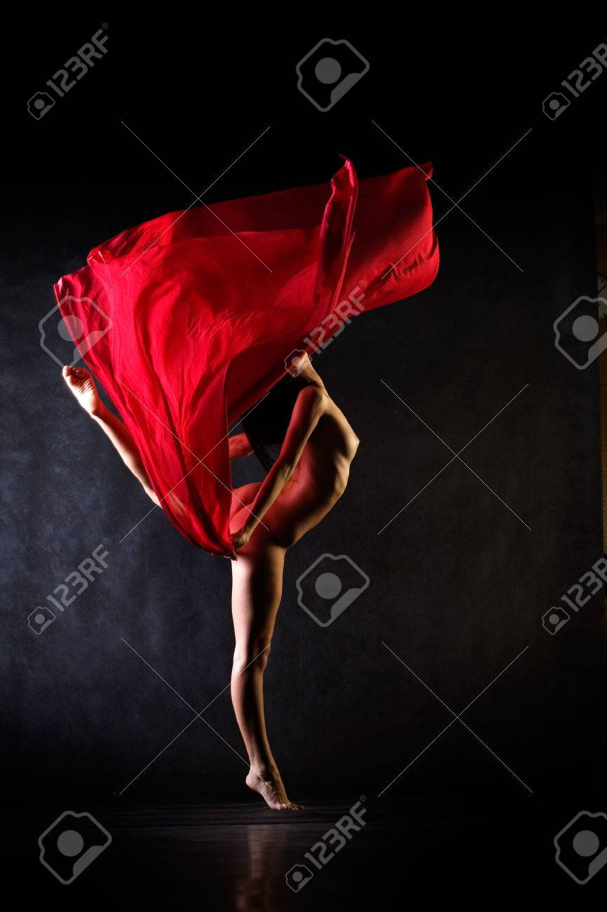 studio dance shot with model and red cloth stock photo picture and