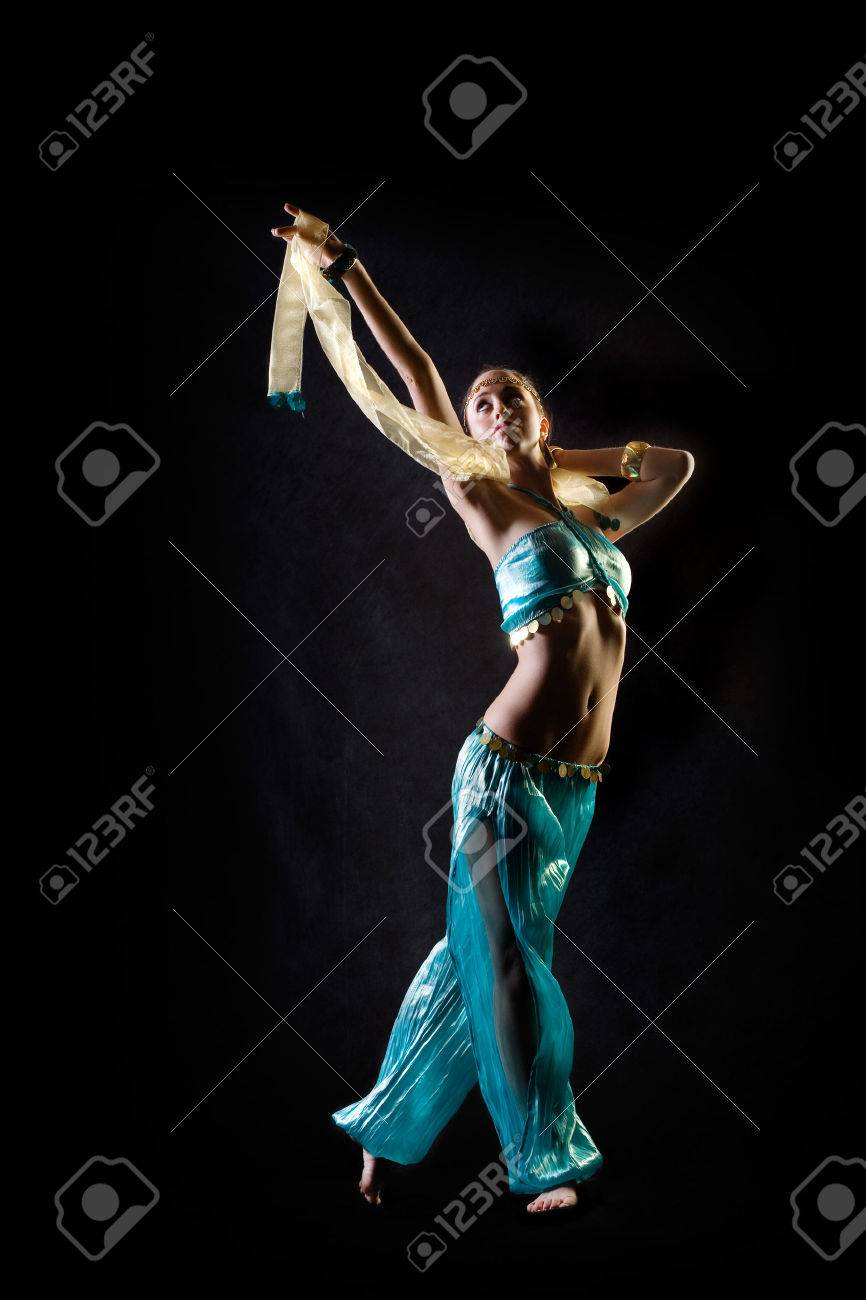 Dancing girl in fantasy arabian harem costume Stock Photo - 1477999