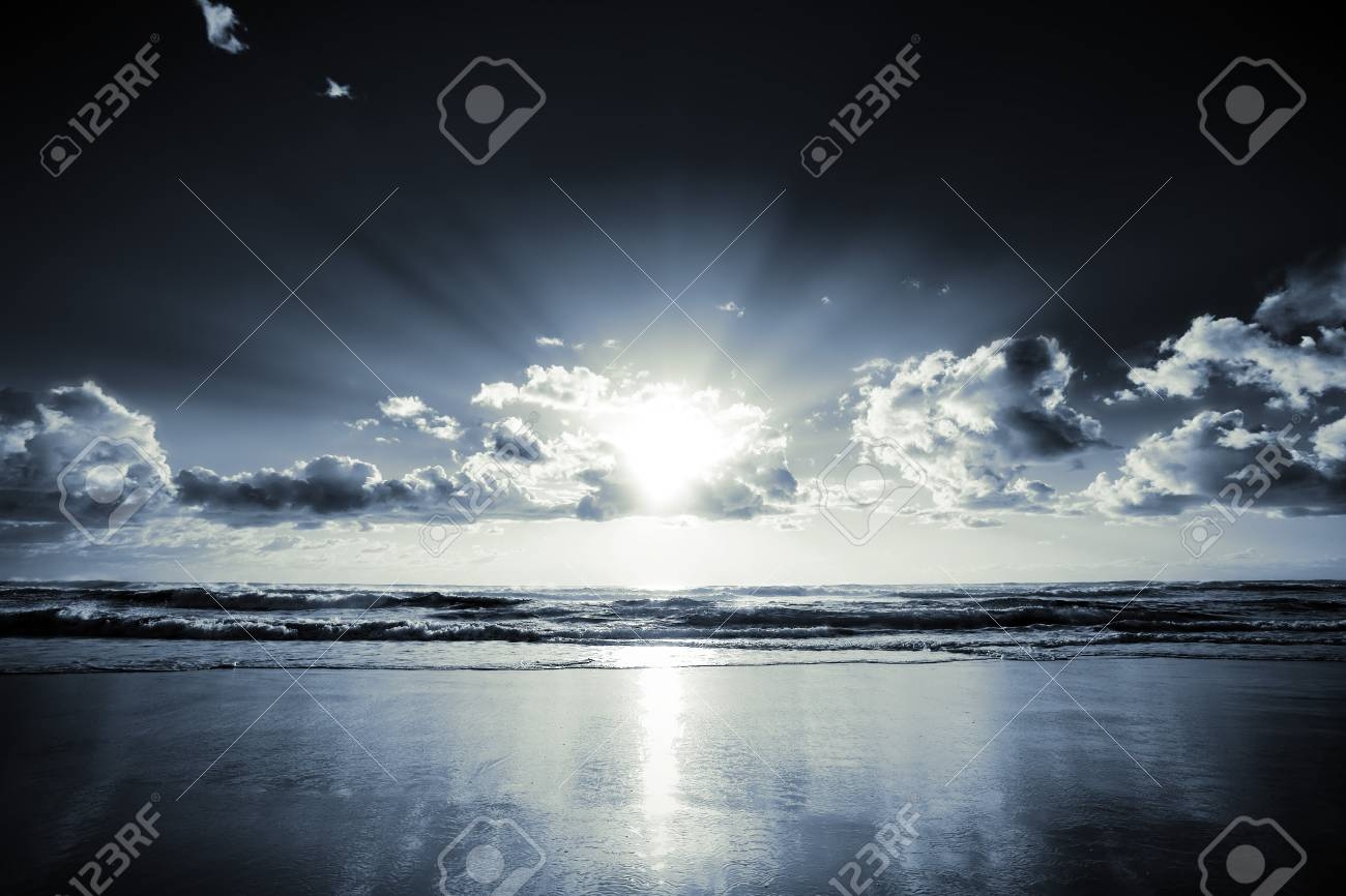 Morning sun bursts through clouds on a beach Stock Photo - 1471332