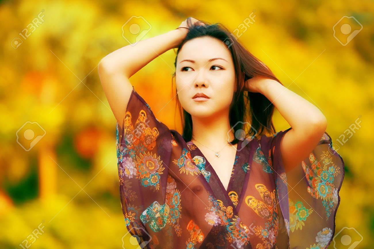 Beautiful Asian fashion model posing in sheer top Stock Photo - 1961239