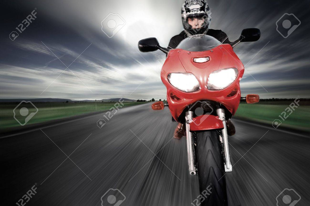 Motorcycle moving very fast along motion blurred road Stock Photo - 6417806
