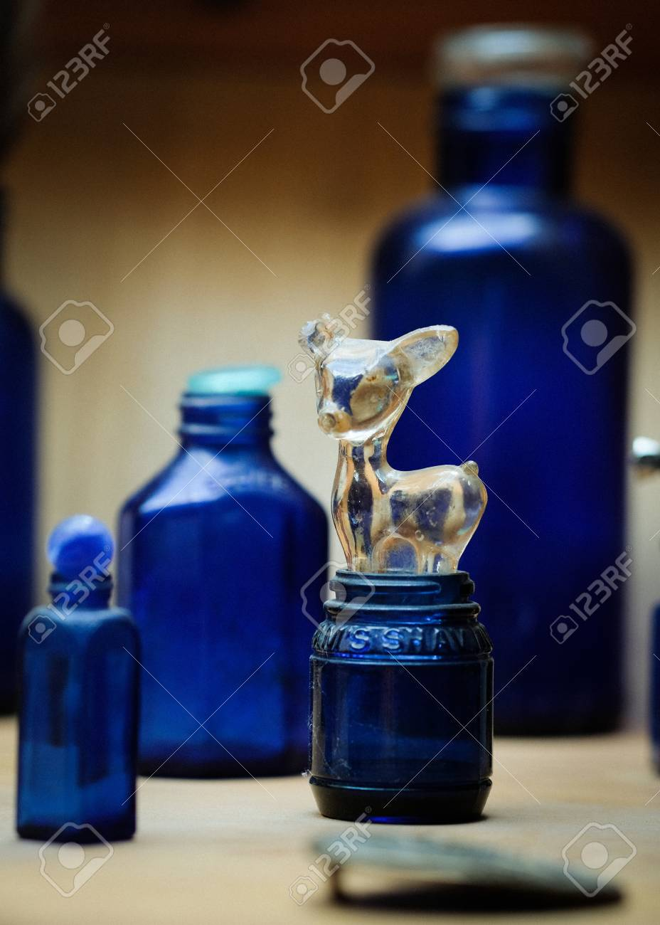 Blue glass bottles and small glass toy from the Wild West period