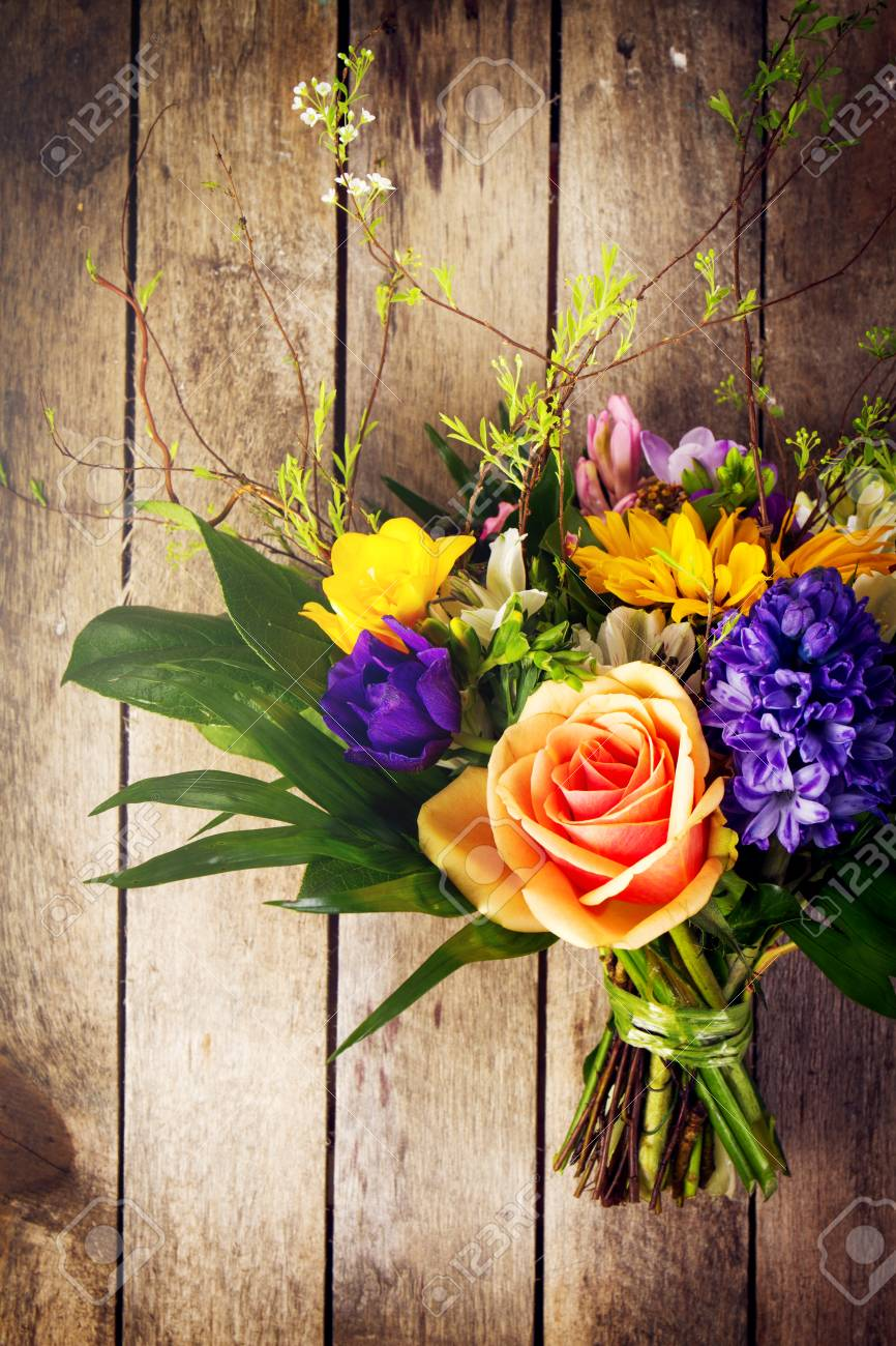 Beautiful Bunch Of Flowers On Wooden Background View From Above
