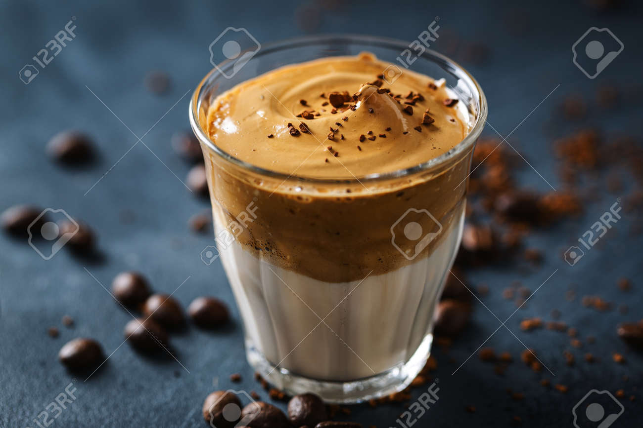 Trendy coffee drink Dalgona with milk and whipped foam made from instant coffee and sugar. - 150666291