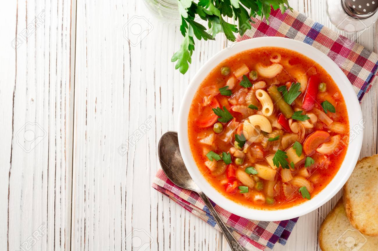 Italian minestrone soup on white wooden background. Top view. - 90920723