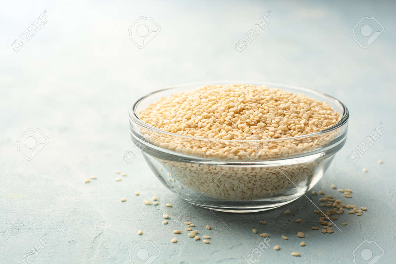 White sesame seeds in glass bowl - 169457266