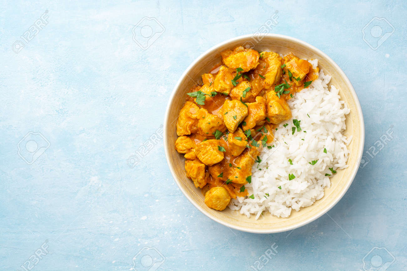 Chicken curry with rice in bowl - 169457499