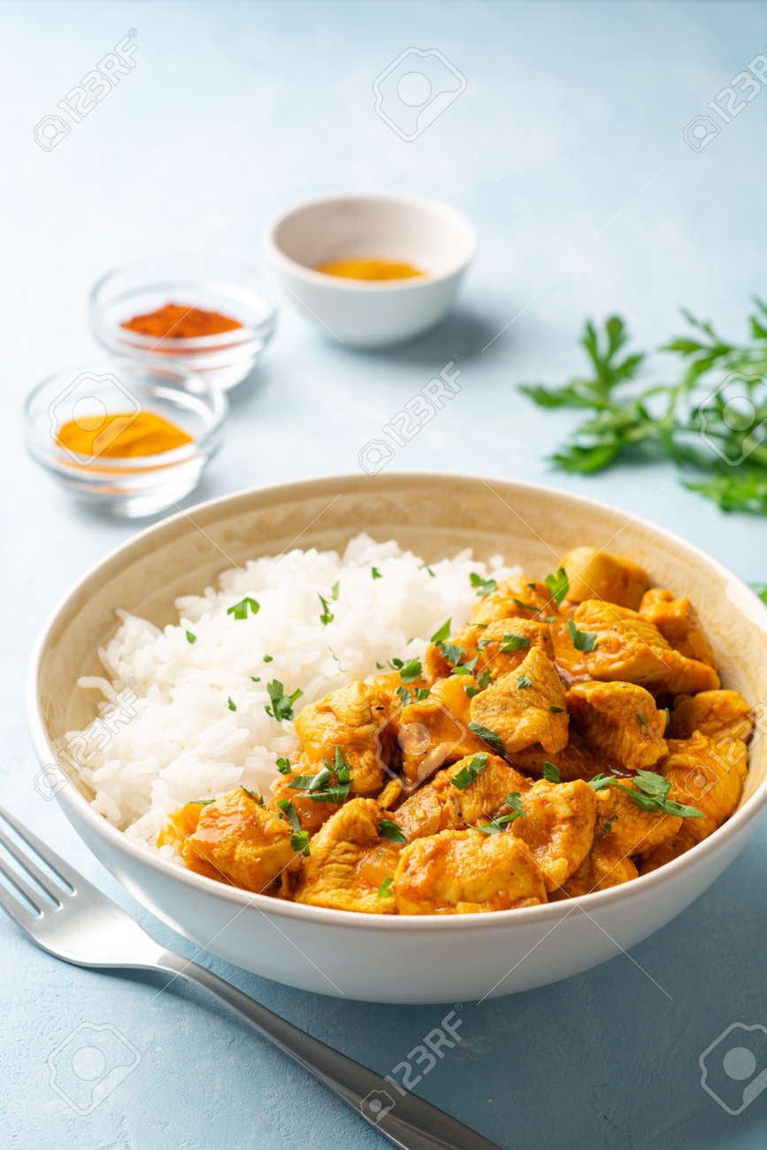 Chicken curry with rice in bowl - 169457497