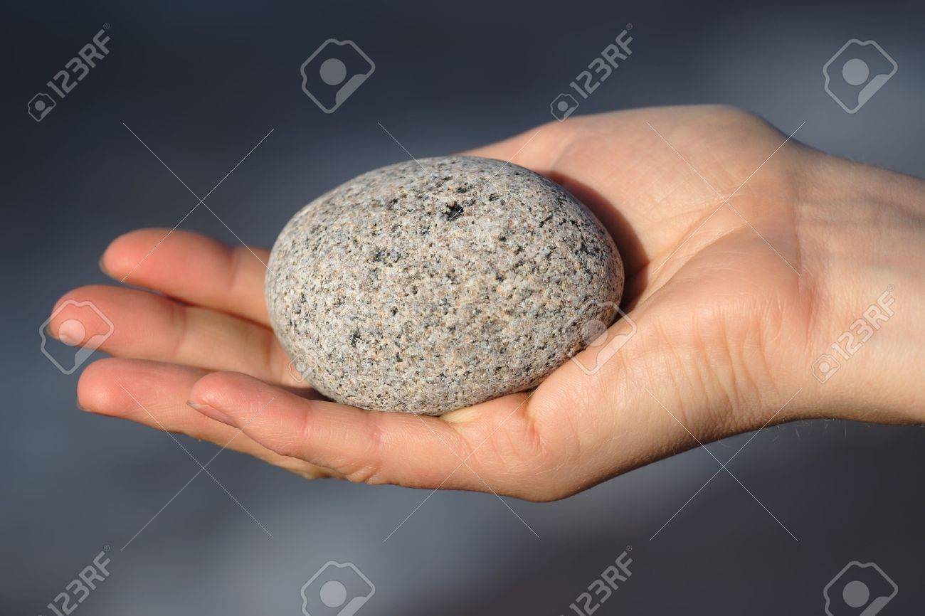 Round stone in a womans hand Stock Photo - 4867678