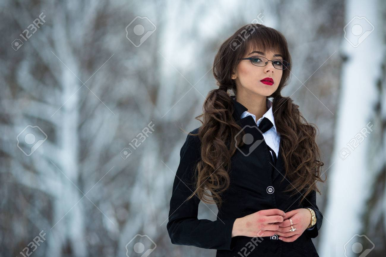 Stock Photo The Beautiful Teacher Student Teacher Schoolgirl Woman In A Suit And A Checkered Skirt Wearing Spectacles Also Looks Is Proud Forward And