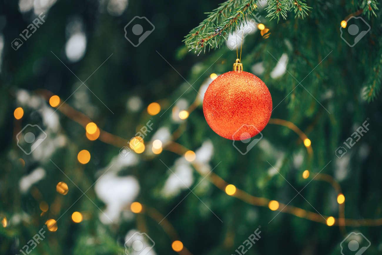 Christmas balls on tree outdoor - 134625457