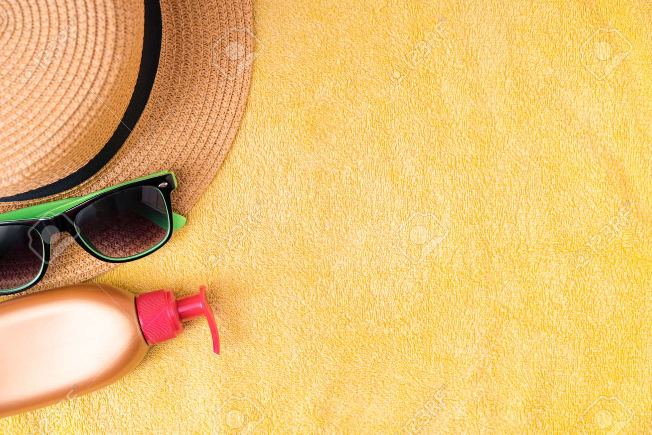 Summer supplies against yellow background. Summer vacation concept. - 169602951