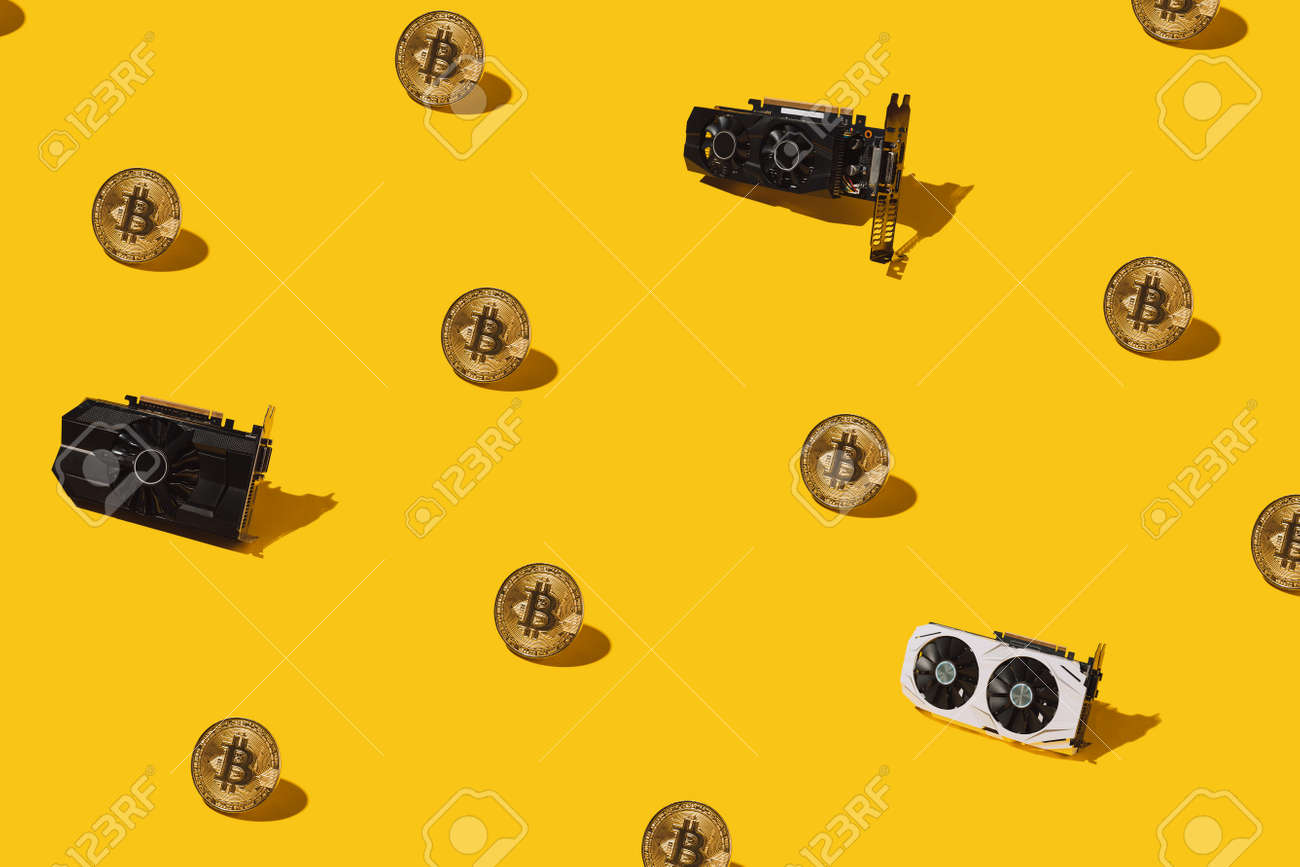 Golden pattern from bitcoin cryptocurrency and video cards. Cryptocurrency mining concept. - 169602962