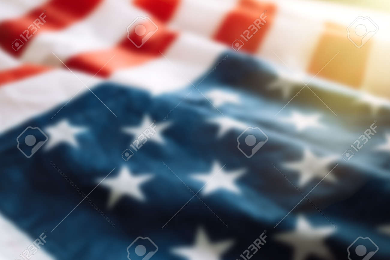Blurred american flag background with sunlight. Fourth july concept. - 169694073