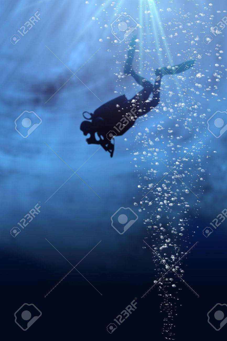 Silhouette of a diver in blue sea Stock Photo - 5151340