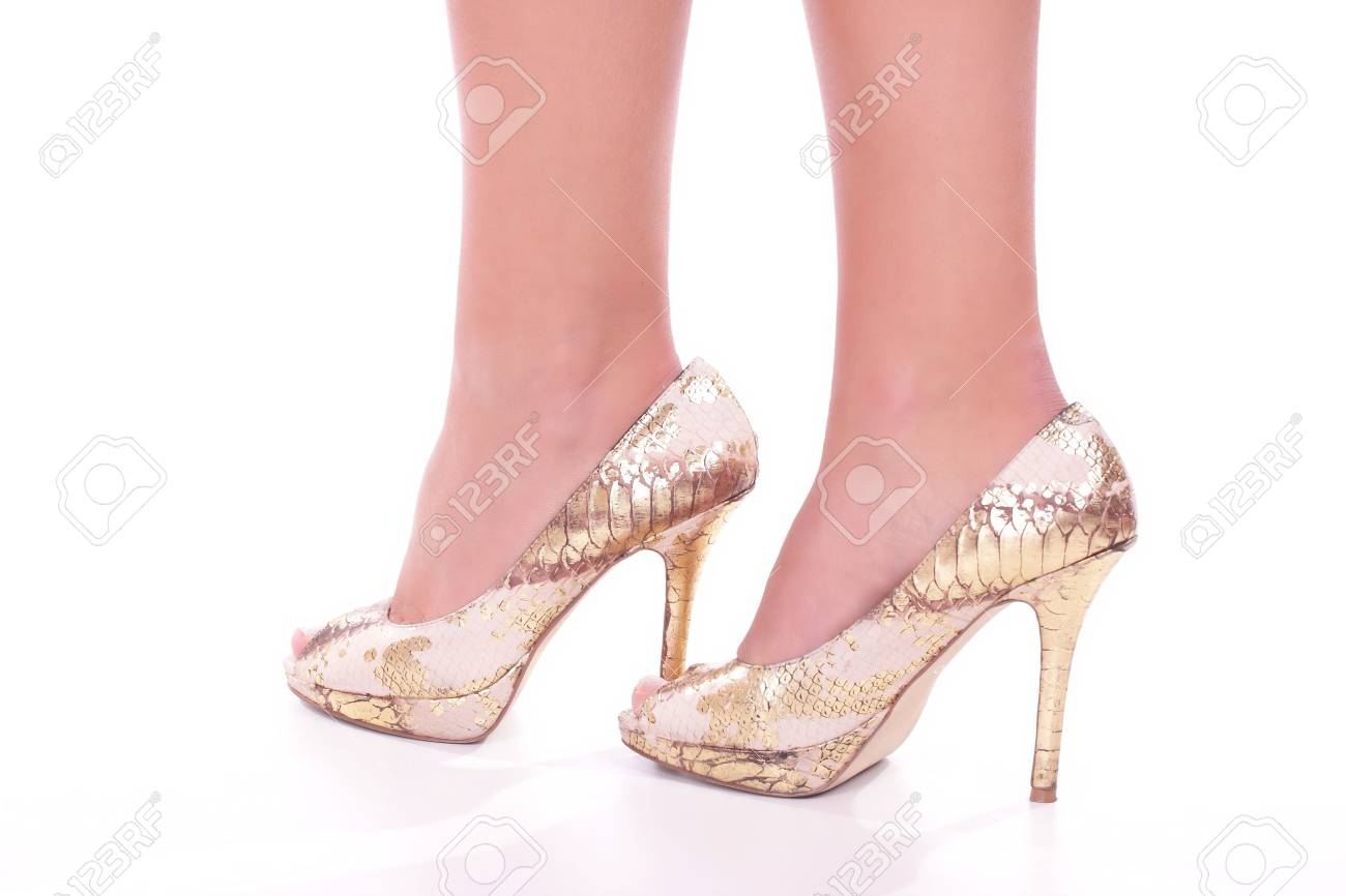 Legs with high heels isolated against a white background Stock Photo - 5842545