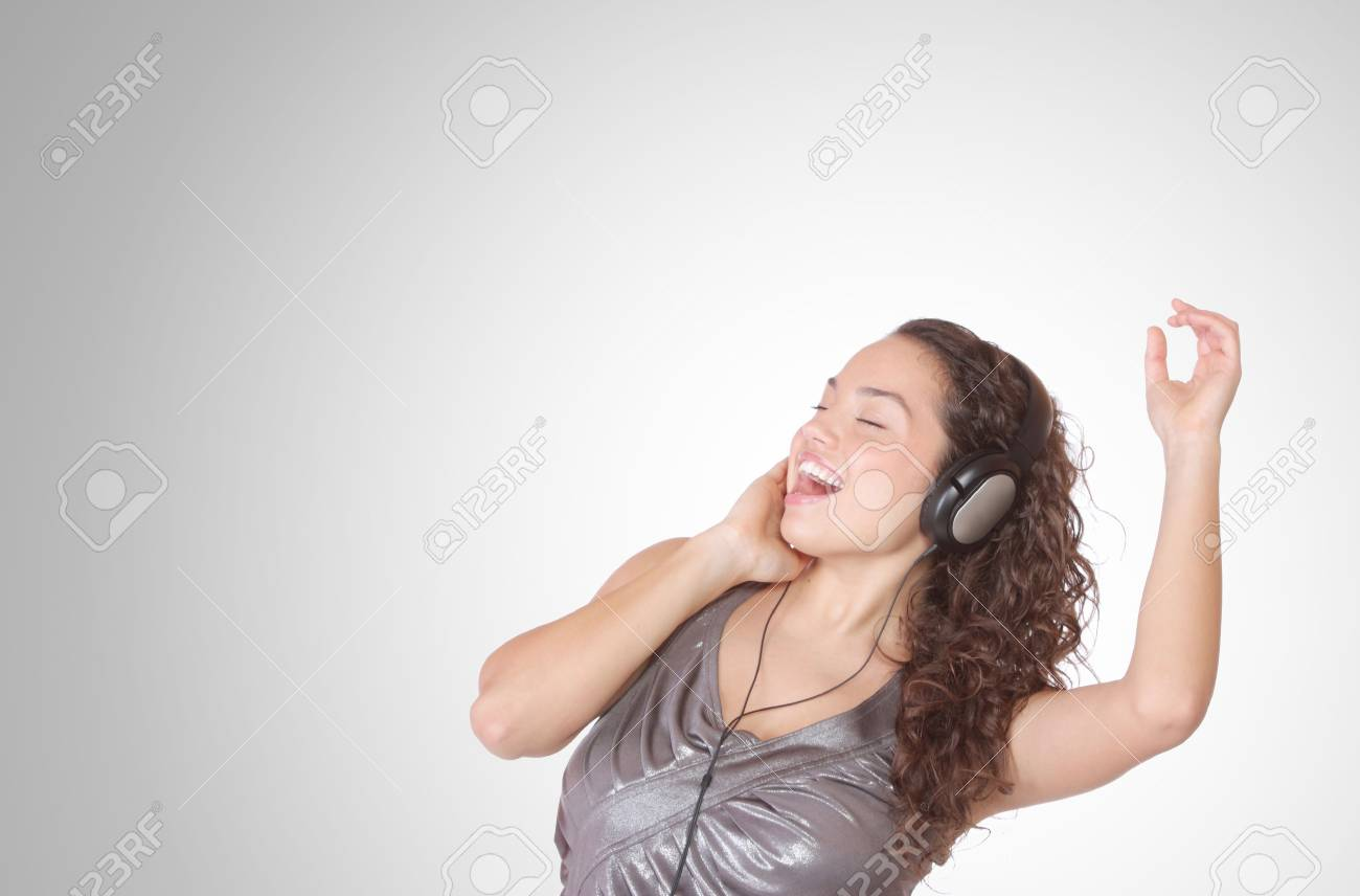Beautiful young woman with headphones  Listening to Music Stock Photo - 6276984