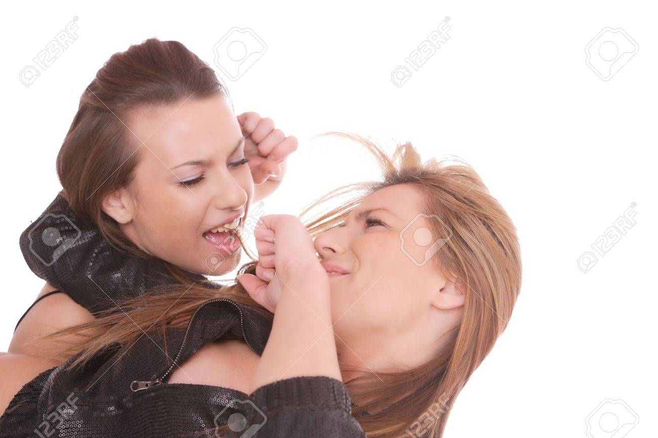 Two young woman fighting over a white background Stock Photo - 6312247