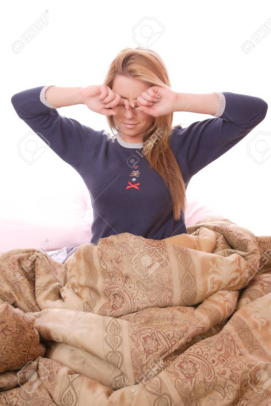 Young beautiful woman waking up in the morning Stock Photo - 6333221