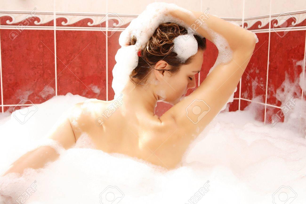 Young woman enjoys bath-foam in the bathtub. Stock Photo - 6364147