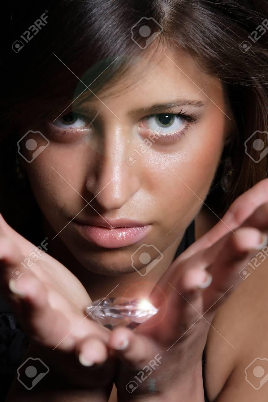 Beautiful girl holding a big diamond in her hand Stock Photo - 6866419