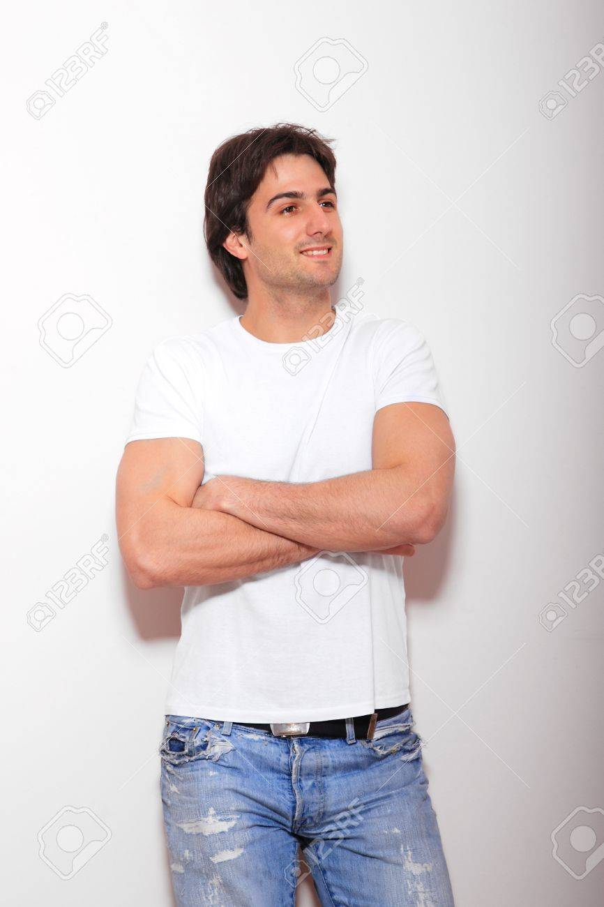White t shirt and blue jeans - White T Shirt Blue Jeans Stock Photo Portrait Of A Young Man Blue Jeans And