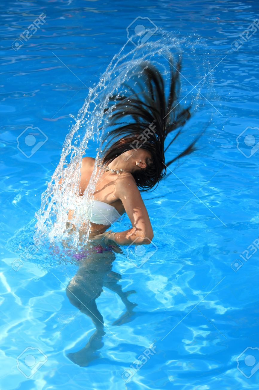 pool water splash. A Beautiful Woman Relaxing In The Pool With Water Splash Stock Photo - 16509351