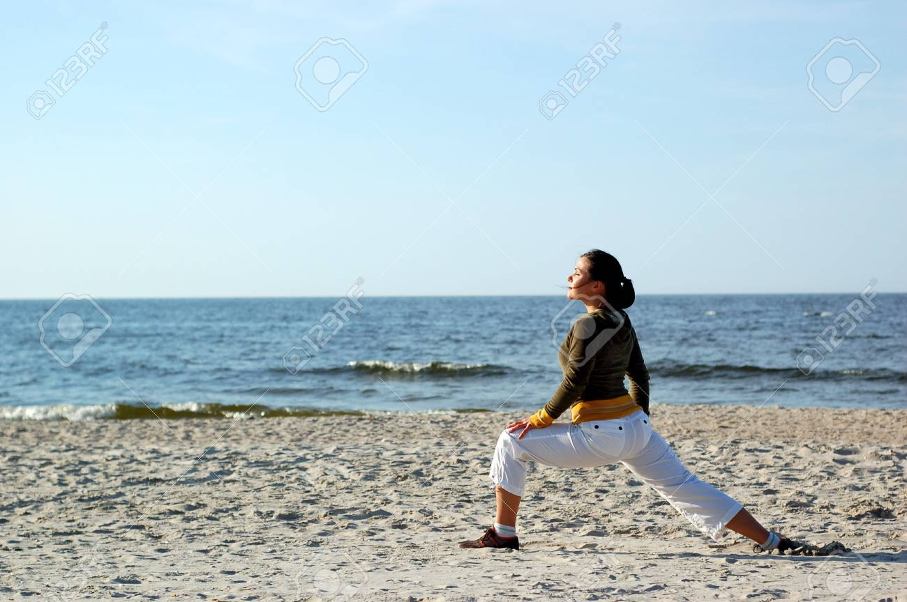 attractive brunette woman doing exercise on the beach Stock Photo - 3039564