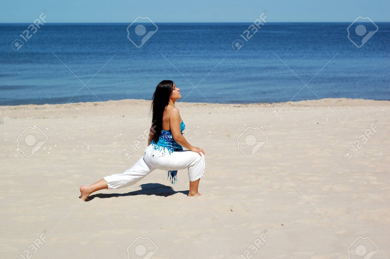 attractive brunette woman doing exercise on the beach Stock Photo - 3039638