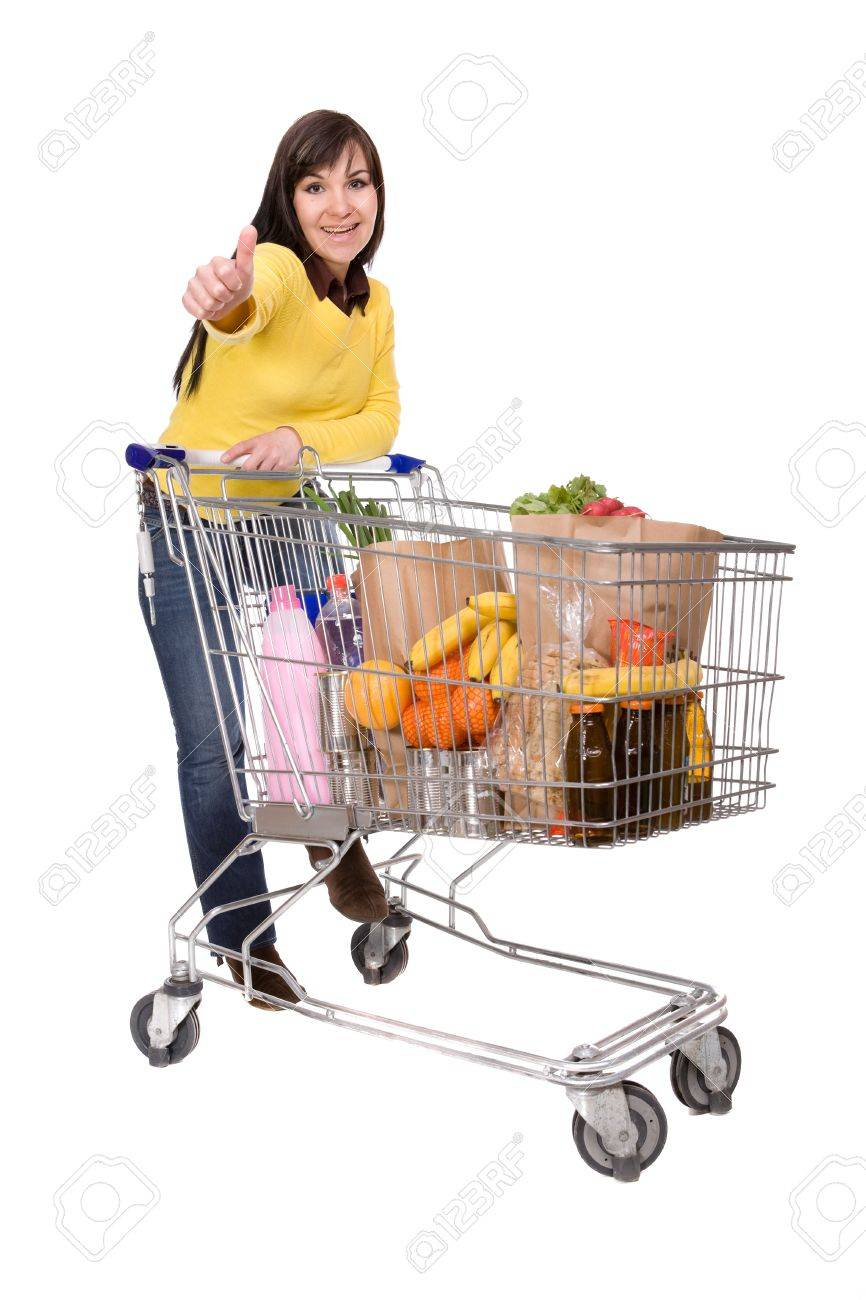 happy brunette woman with shopping cart. over white background Stock Photo - 4737391