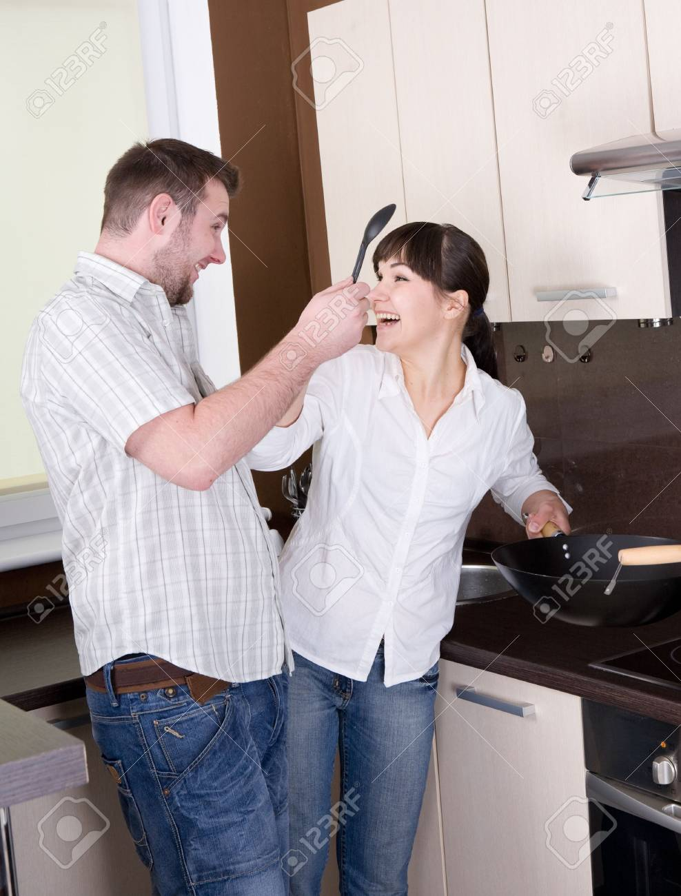 happy young couple having fun in kitchen Stock Photo - 5417402