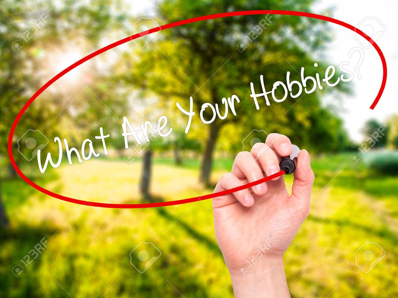 man hand writing what are your hobbies black marker on man hand writing what are your hobbies black marker on visual screen isolated