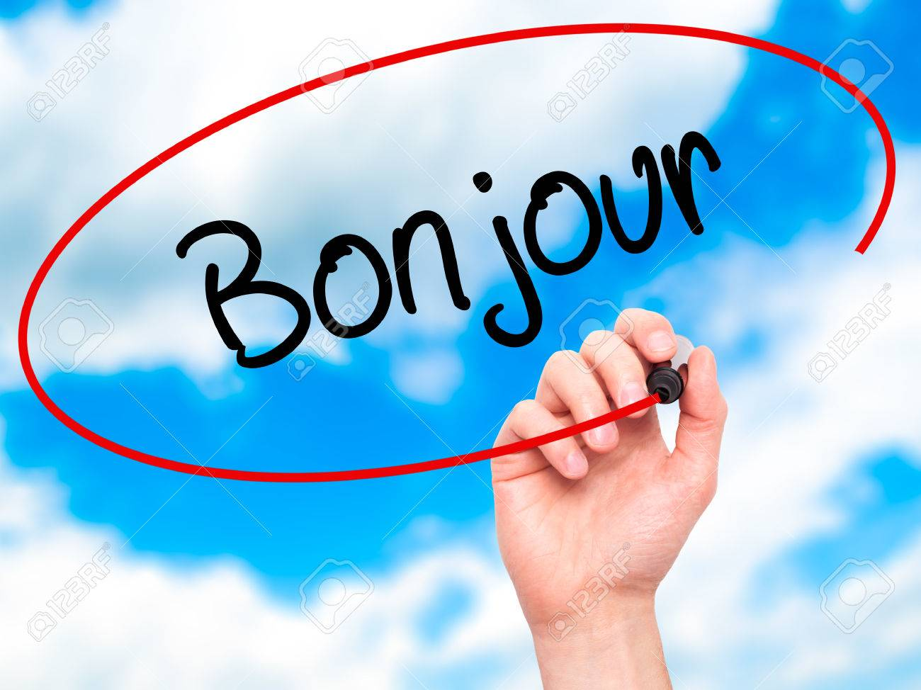 Man Hand Writing Bonjour Good Morning In French With Black Stock