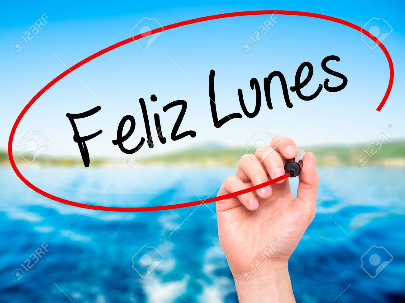 Man Hand Writing Feliz Lunes Happy Monday In Spanish With Black