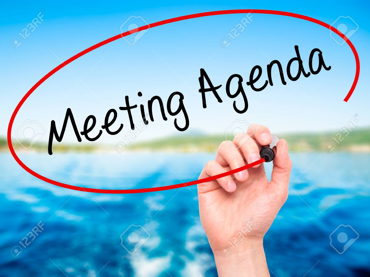 Man Hand Writing Meeting Agenda With Black Marker On Visual.. Stock ...