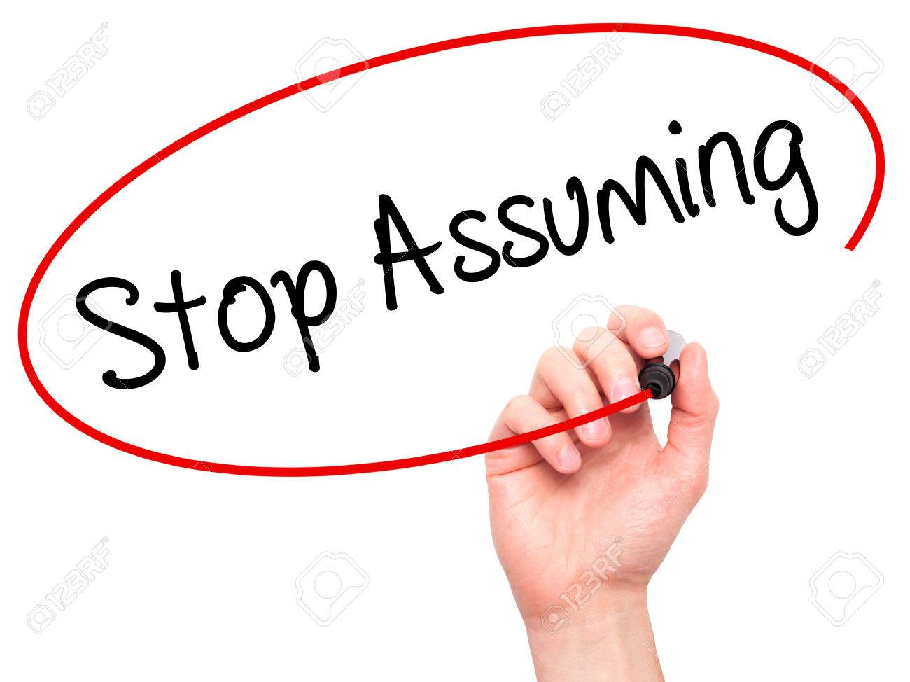 Man Hand Writing Stop Assuming With Black Marker On Visual Screen... Stock  Photo, Picture And Royalty Free Image. Image 52991818.