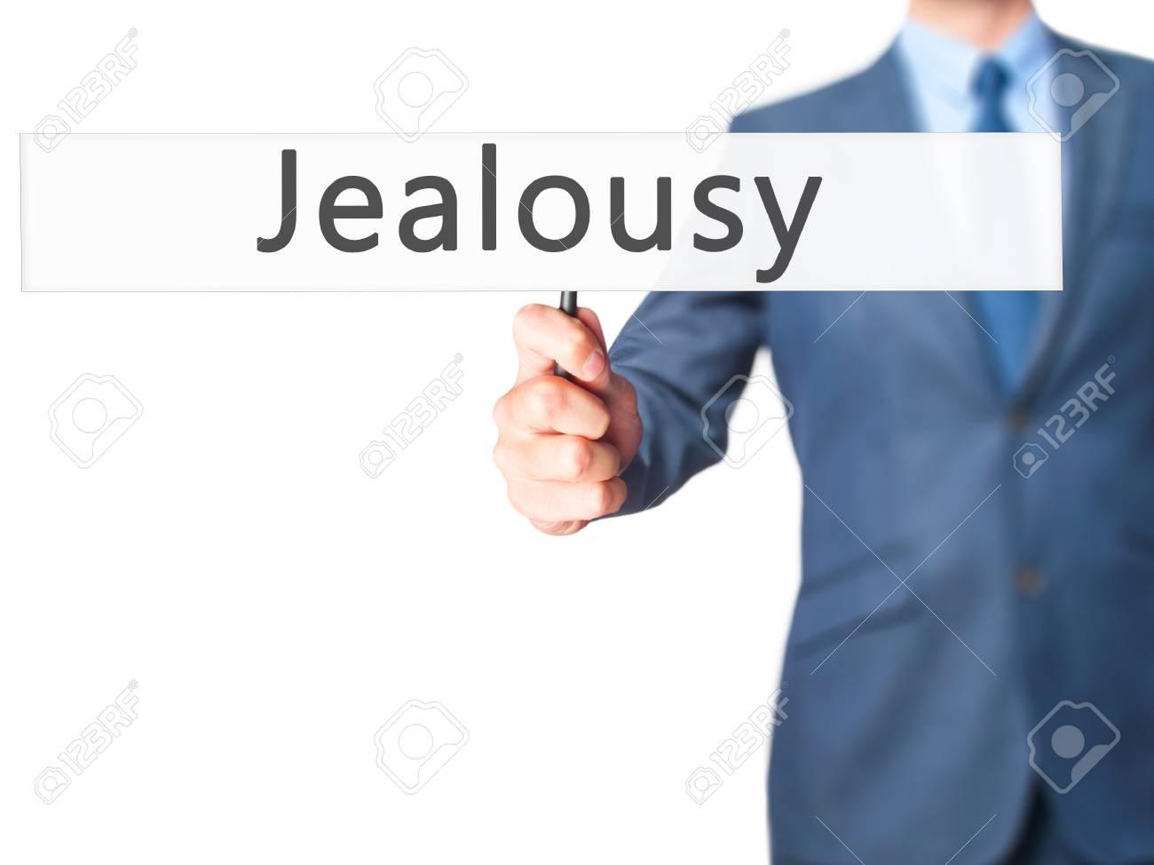 Jealousy - Businessman hand holding sign  Business, technology,