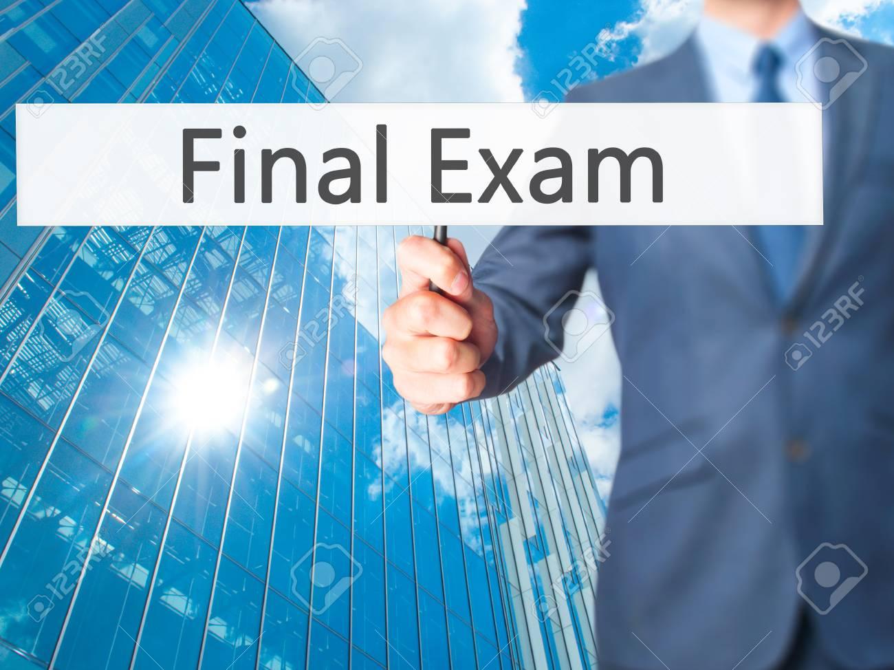 Final Exam - Businessman hand holding sign  Business, technology,