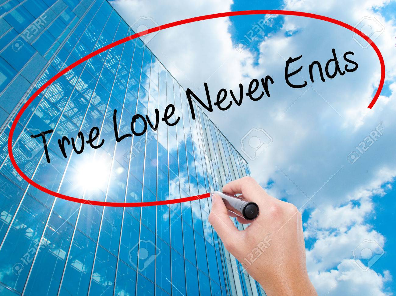 Man Hand Writing True Love Never Ends With Black Marker On Visual